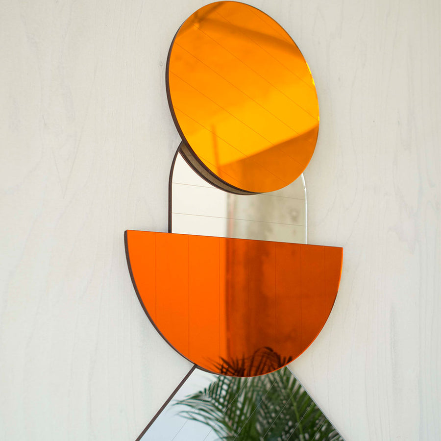 Layered mirrors in amber and orange - shop now