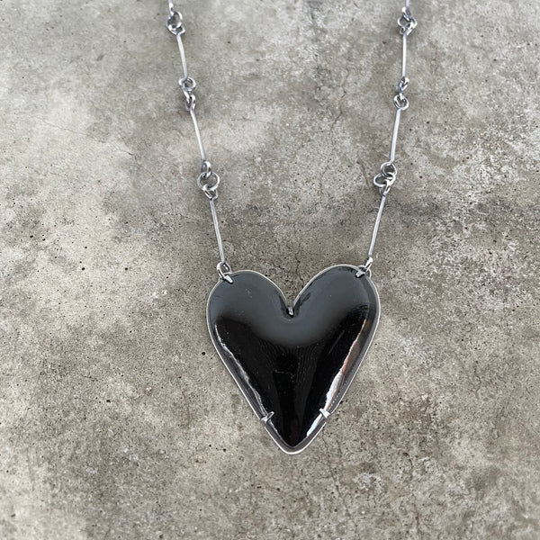 black enamel heart necklace set in oxidized sterling silver