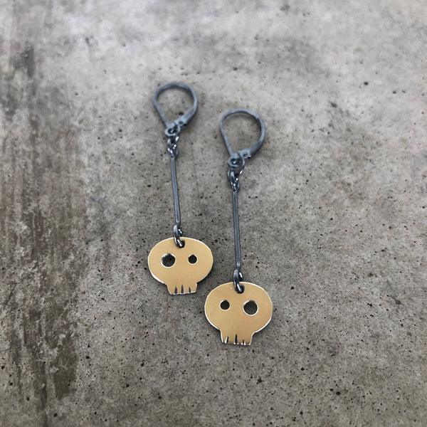 two tone skull earrings