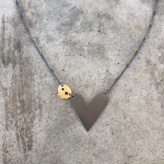 asymmetrical heart skull necklace