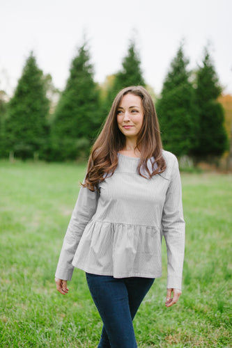 grey and white tiered top with long sleeves