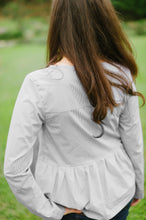 back view of grey and white tiered top with long sleeves