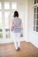 back of blue and white striped double peplum top, peplum design goes all the way around.
