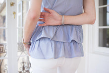 a close up of the double peplum detail