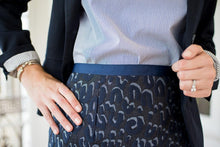 close up of leopard pattern on denim jacquard skirt, featuring different tones of blue.