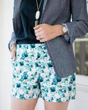 close up of floral shorts featuring pockets and wide waistband