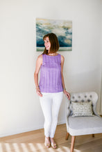 lilac textured top featuring a checked pattern created through the weave of the fabric