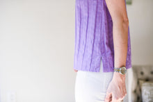 a side view of the lilac textured top featuring side seam splits