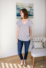 model wearing floral v neck top with dark denim