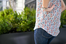 view of the curved hemline on floral top from side view