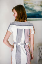 back view of striped dress featuring a yolk