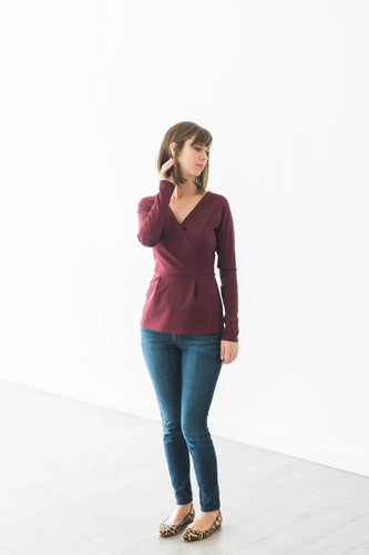 faux wrap top in burgundy styled with dark denim