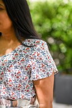 close up of tulip sleeve detail on floral top