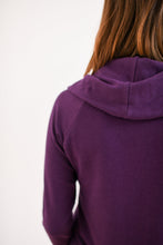 close up view of the cowl neck detail from the back in plum
