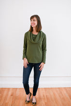 model wearing cowl neck top in moss with dark denim