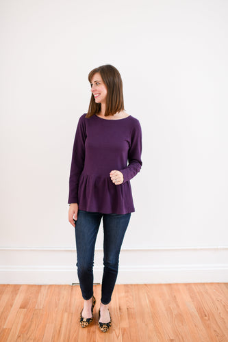 peplum sweatshirt in plum paired with dark denim