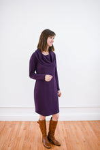 cowl neck dress in plum styled with cognac boots.