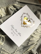Baby Footprints in a heart shape created in sparkly gold foil and feature a heart wreath and your babys birth details