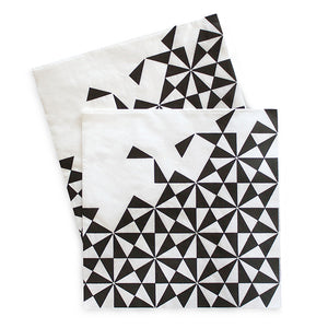 Napkin has white base with black geo print on 3/4 of the napkin