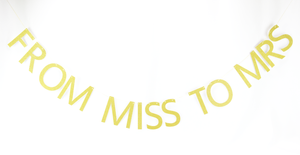 gold party banner: from Miss to Mrs