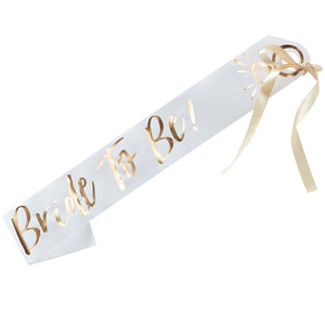 gold ribbon, paper sash, party