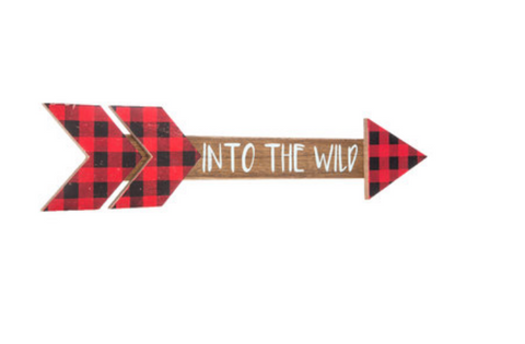 This wood arrow features red & black plaid arrows and font reading into the wild in white