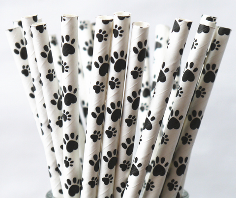 white paper straw with black puppy paw all over print for dog themed and puppy parties