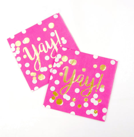 Hot pink beverage napkin with Yay! printed in gold foil