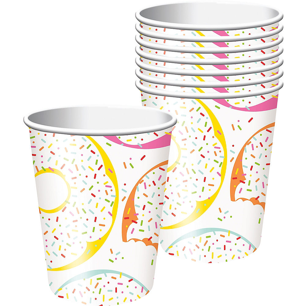 white paper cup with colorful donut and sprinkle pattern