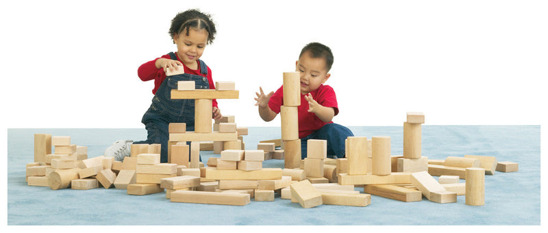2 children playing with wooden block set