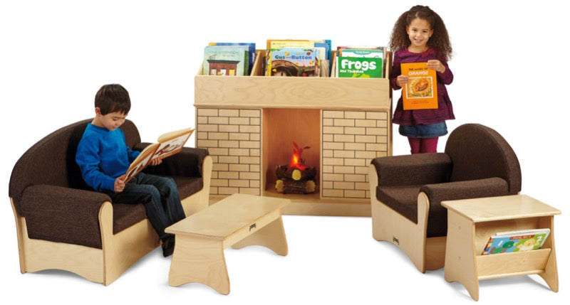 Fireplace themed bookshelf in seating area with kids