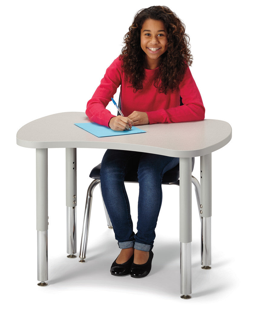 Girl sitting at a bowtie shaped table