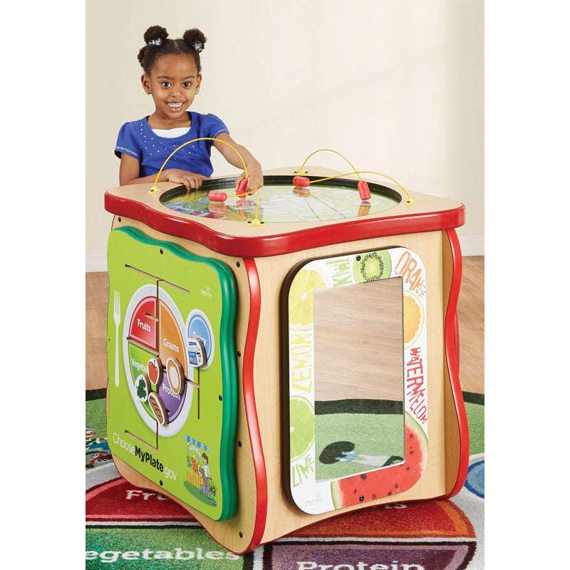 Child height play cube with activities on four sides and the top