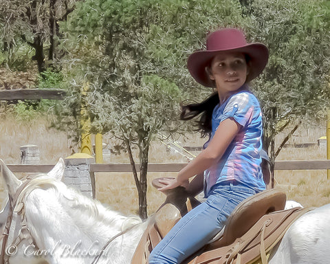 Adorable Little Mexican girl on white horse