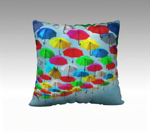 throw pillow featuring an original, watercolor painting by Janice Lawrence of colorful umbrellas providing shade in downtown Saumur, France.