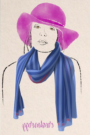 silky scarf patterned with blue and pink stripes and dots.