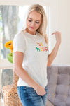 A Women Wearing a Be Happy Adult Tee