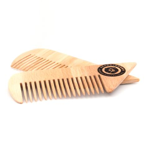 wooden comb with beard and brawn logo branded into the wood