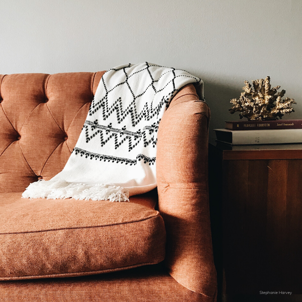 Comfortable Couch with throw