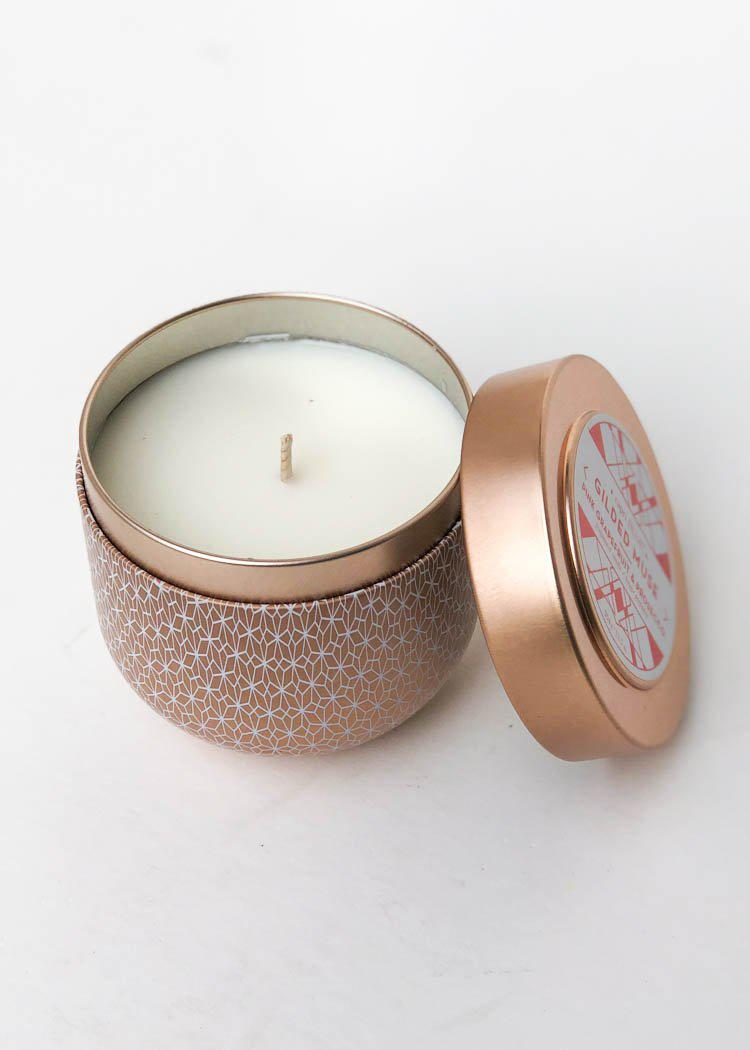 Capri Blue Gilded Muse Pink Grapefuit and Prosecco Tin Candle-Hand In Pocket