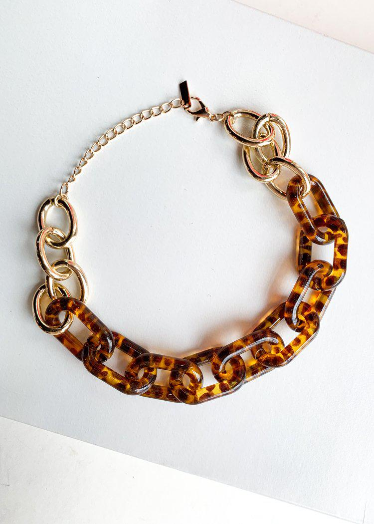 Si Racha Acrylic Gold Tortoise Linked Chain Necklace-Hand In Pocket