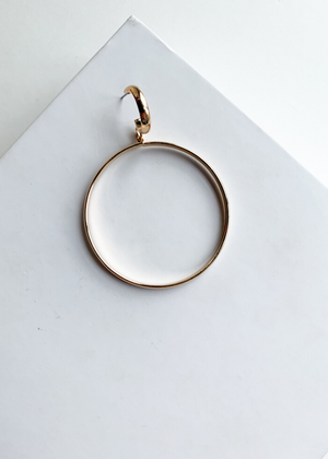 Kashid Gold Medium Hoops-Hand In Pocket