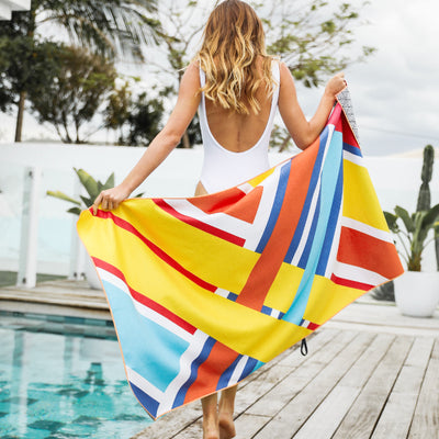 Tesalate - Between The Flags Beach Towel