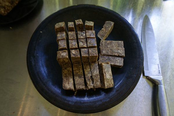 Slicing up African Black Soap
