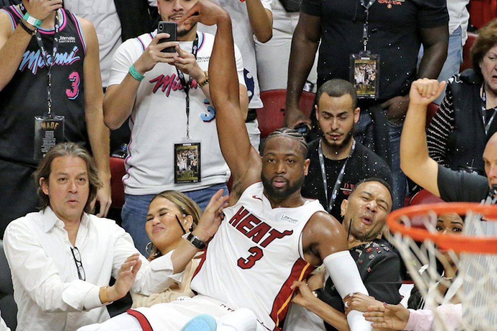 Dwyane Wade Falls Into Chrissy Teigen, The Memes Are Gold