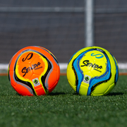 two senda amador training soccer balls on the field
