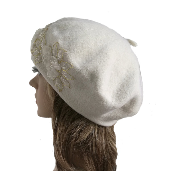 White winter women's  wool beret made of felted wool