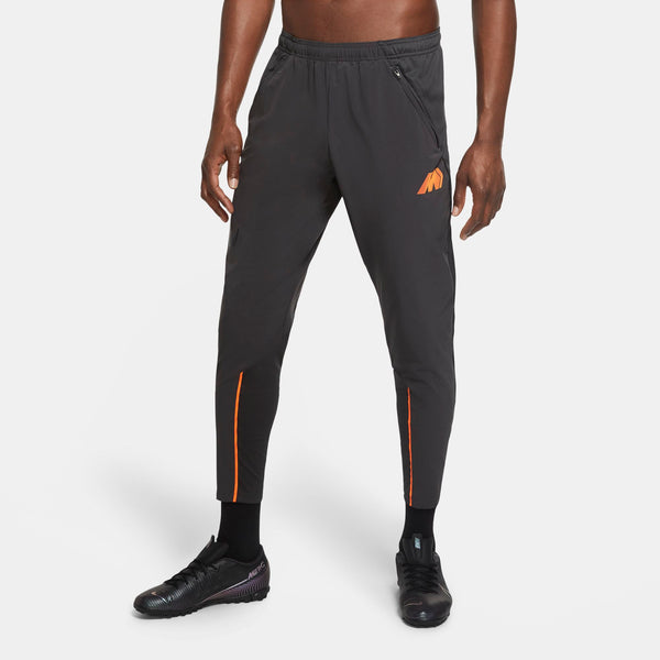 NIKE MERCURIAL WOVEN PANT SMOKE GREY/TOTAL ORANGE/TOTAL ORAN
