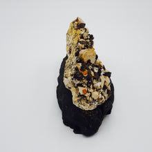Spessartine with Smoky Quartz on Microcline