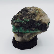 Emerald on Quartz matrix